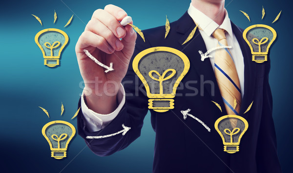 Stockfoto: Zakenman · idee · gloeilamp · hand · man · licht