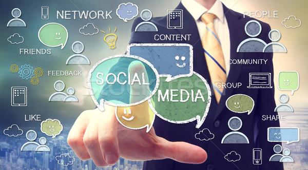 Businessman with social media concepts Stock photo © Melpomene