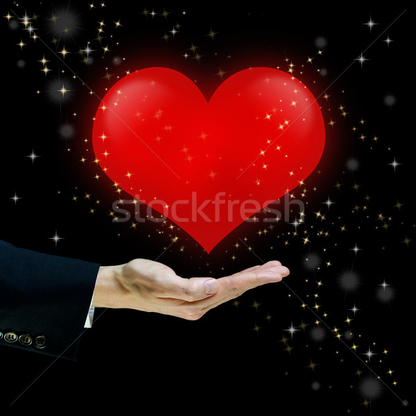 Red heart floating over a hand Stock photo © Melpomene