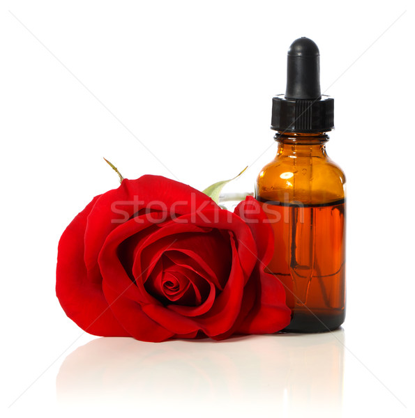 Stock photo: Dropper bottle with red rose
