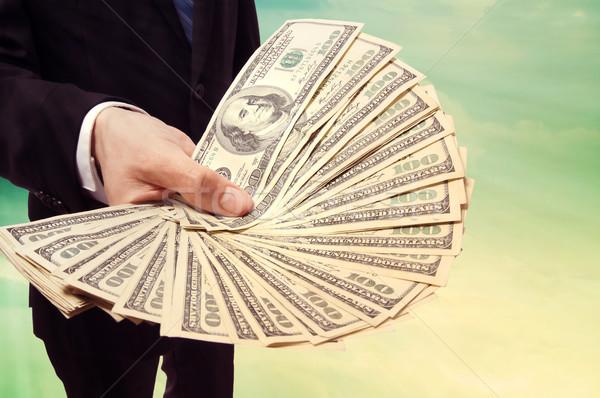 Business Man Displaying a Spread of Cash Stock photo © Melpomene