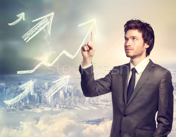 Businessman pointing rising arrows Stock photo © Melpomene