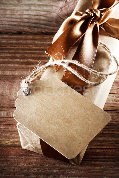 Handmade paper tag with gift box  Stock photo © Melpomene
