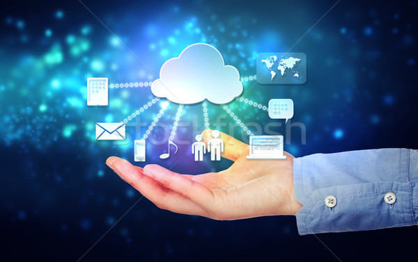 Hand holding hovering cloud computing concept Stock photo © Melpomene