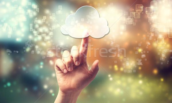 Cloud computing symbol being pressed by hand Stock photo © Melpomene