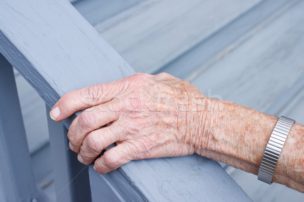 Senior lady holding a stair rail Stock photo © Melpomene