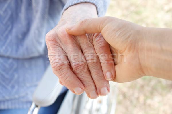 Tart idősek kéz fiatal idős tolószék Stock fotó © Melpomene