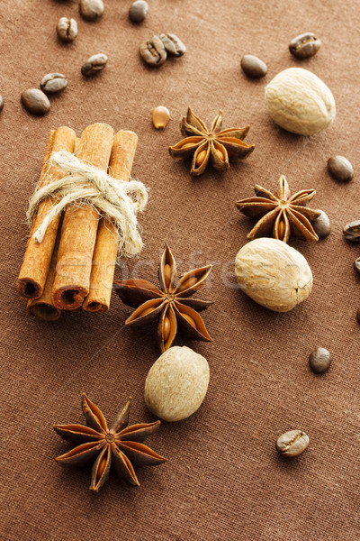 Star anise, cinnamon sticks, nutmeg and coffee beans Stock photo © Melpomene