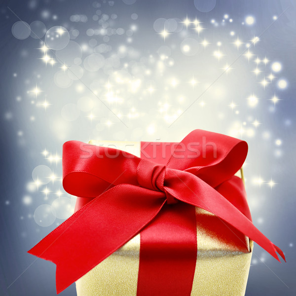 Golden gift box with big red ribbon  Stock photo © Melpomene