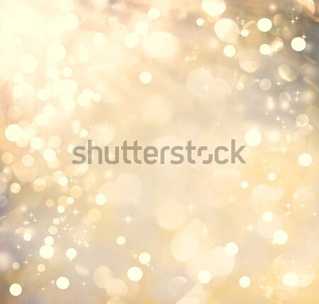 Stock photo: Golden colored abstract shiny light background