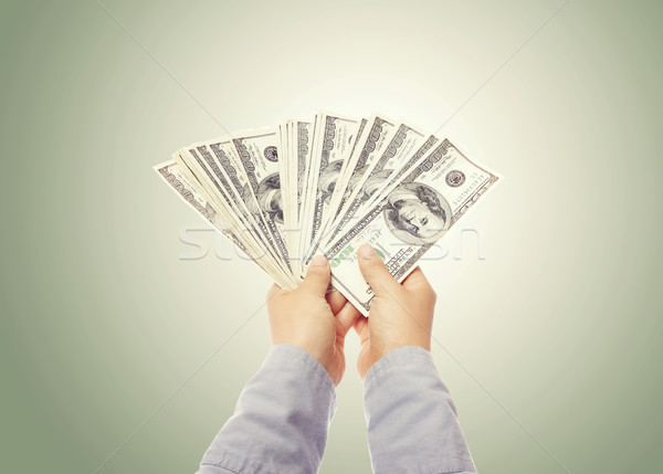 Hand Displaying a Spread of Cash Stock photo © Melpomene