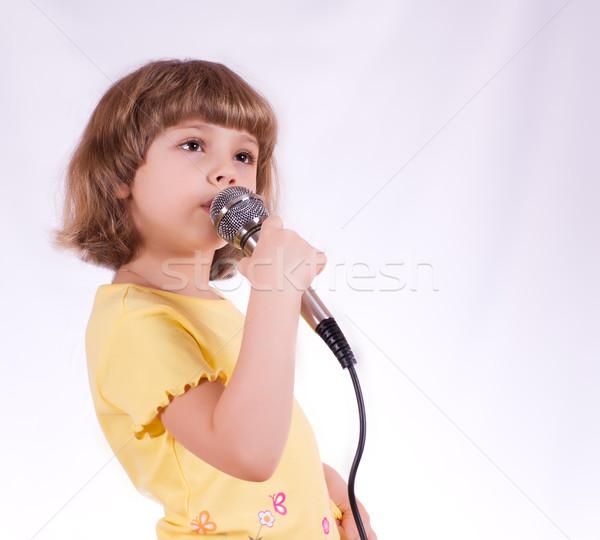 Little singer Stock photo © MichaelVorobiev