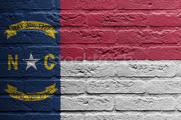 Téglafal festmény zászló Észak-Karolina izolált fal Stock fotó © michaklootwijk