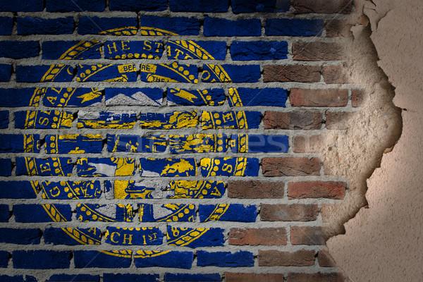 Escuro parede de tijolos gesso Nebraska textura bandeira Foto stock © michaklootwijk