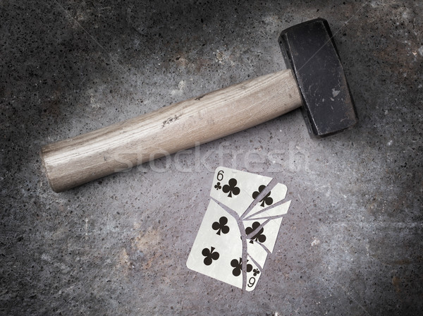 Hammer with a broken card, six of clubs Stock photo © michaklootwijk