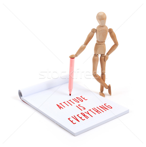 Wooden mannequin writing - Attitude is everything Stock photo © michaklootwijk