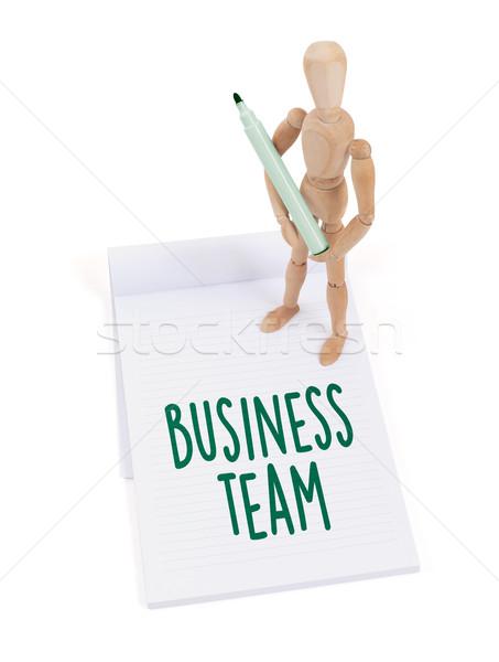 Houten etalagepop schrijven business team plakboek papier Stockfoto © michaklootwijk