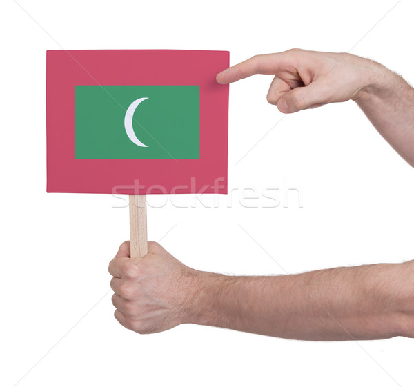 Hand holding small card - Flag of Maldives Stock photo © michaklootwijk