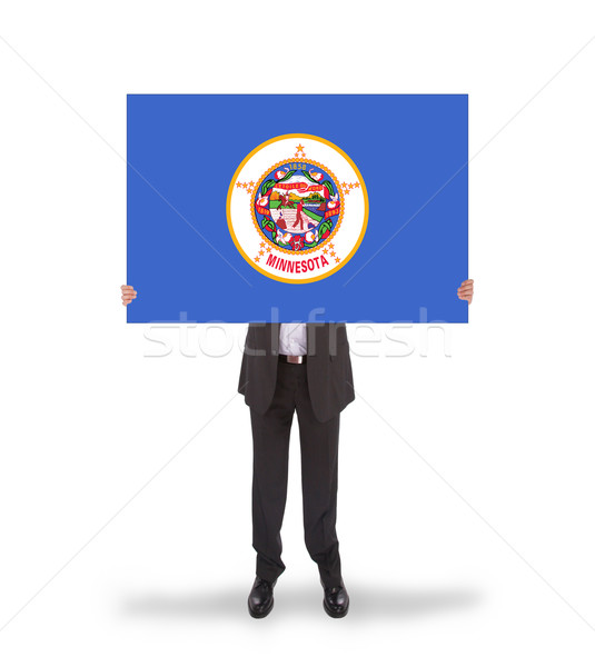 Smiling businessman holding a big card, flag of Minnesota Stock photo © michaklootwijk