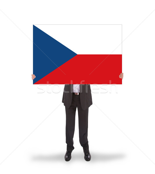 Smiling businessman holding a big card, flag of the Czech Republ Stock photo © michaklootwijk