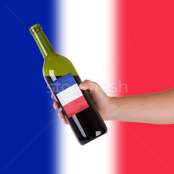 Mano botella vino tinto etiqueta Francia Foto stock © michaklootwijk