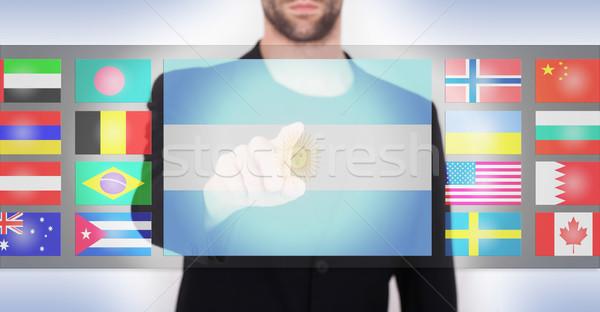 Kéz toló érintőképernyő interfész választ nyelv Stock fotó © michaklootwijk