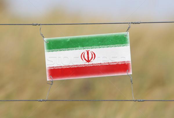 границе забор старые пластиковых знак флаг Сток-фото © michaklootwijk