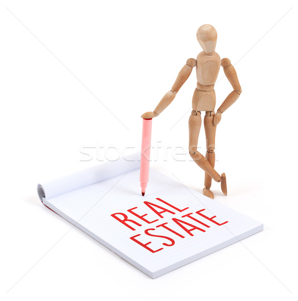 Wooden mannequin writing - Real estate Stock photo © michaklootwijk