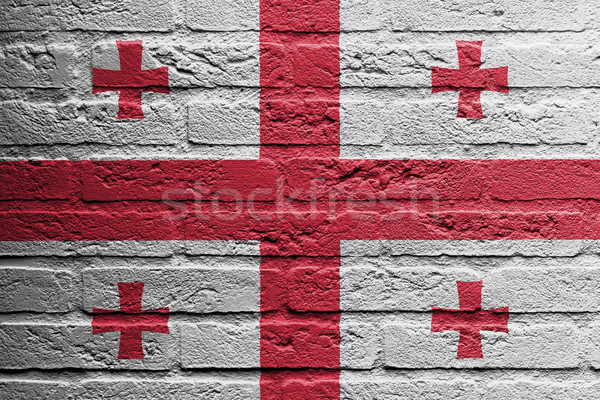 Brick wall with a painting of a flag, Georgia Stock photo © michaklootwijk