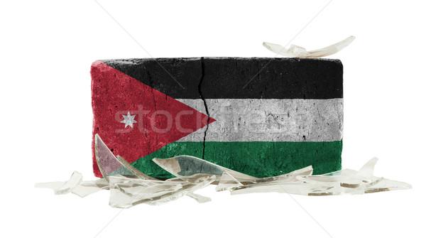 Tijolo cacos de vidro violência bandeira Jordânia parede Foto stock © michaklootwijk