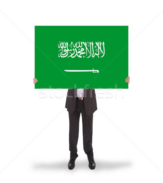 Businessman holding a big card, flag of Saudi Arabia Stock photo © michaklootwijk
