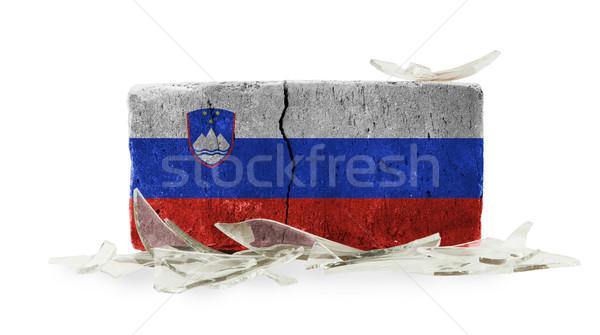 Mattone vetri rotti violenza bandiera Slovenia muro Foto d'archivio © michaklootwijk