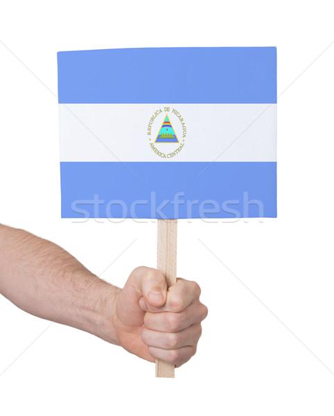 Kéz tart kicsi kártya zászló Nicaragua Stock fotó © michaklootwijk