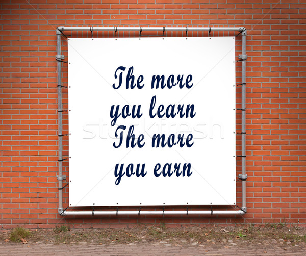 Large banner with inspirational quote on a brick wall Stock photo © michaklootwijk