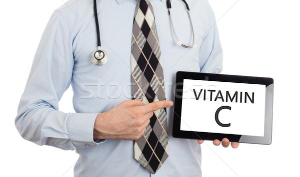 Orvos tart tabletta c vitamin izolált fehér Stock fotó © michaklootwijk