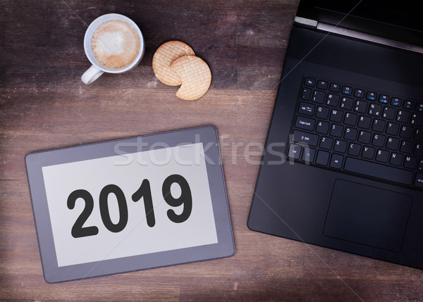 Tablet touch computer gadget on wooden table - 2019 Stock photo © michaklootwijk