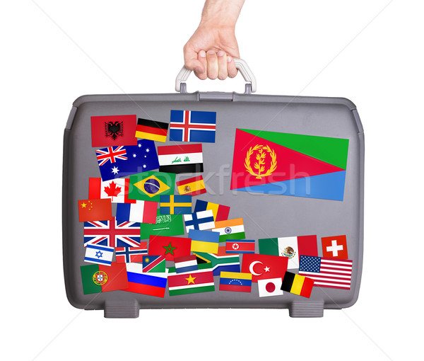 Used plastic suitcase with stickers Stock photo © michaklootwijk