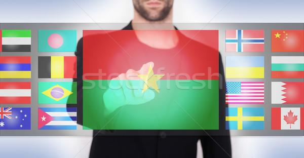 手 プッシング タッチスクリーン インターフェース 言語 ストックフォト © michaklootwijk