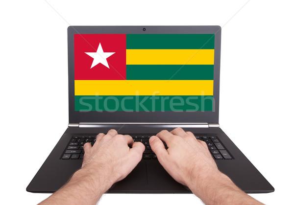 Ręce pracy laptop Togo ekranu Zdjęcia stock © michaklootwijk