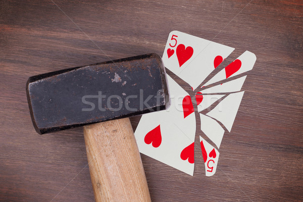 Hammer with a broken card, five of hearts Stock photo © michaklootwijk