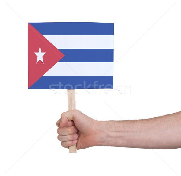 Mão pequeno cartão bandeira Cuba Foto stock © michaklootwijk