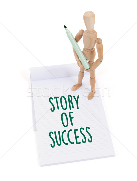 Wooden mannequin writing - Story of success Stock photo © michaklootwijk