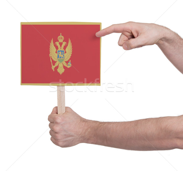 Hand holding small card - Flag of Montenegro Stock photo © michaklootwijk