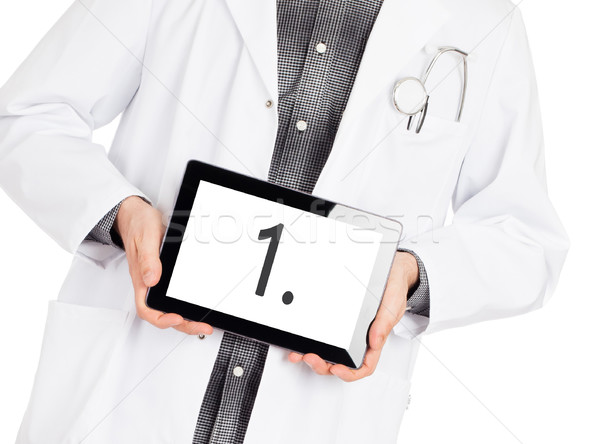 Doctor holding tablet - Number 1 Stock photo © michaklootwijk