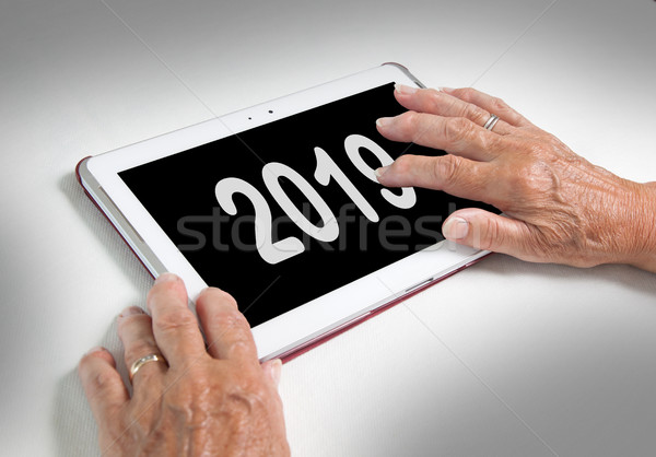 Senior lady relaxing and her tablet - 2019 Stock photo © michaklootwijk