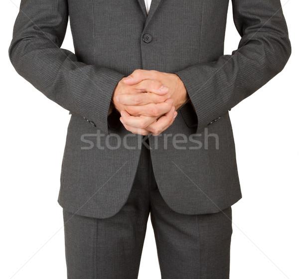 Business man in grey suit praying Stock photo © michaklootwijk