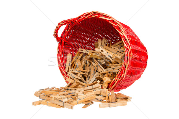 Very old red basket with wooden clothespins Stock photo © michaklootwijk