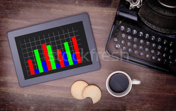 Tablet touch computer gadget tavolo in legno grafico Foto d'archivio © michaklootwijk