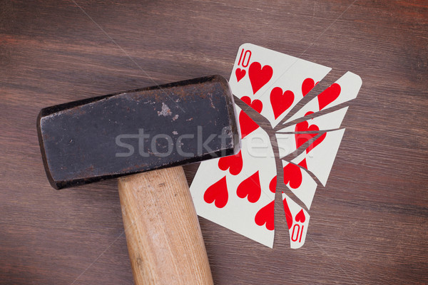 Stock photo: Hammer with a broken card, ten of hearts