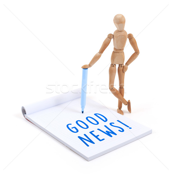 Wooden mannequin writing in scrapbook - Good news Stock photo © michaklootwijk